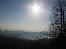 Sun And Blue Mountains Royalty Free Stock Photos