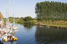 River Scene With Boats & People Royalty Free Stock Images