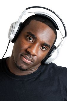 Free Young Man Listenning To Music On Headphones Royalty Free Stock Images - 10200319