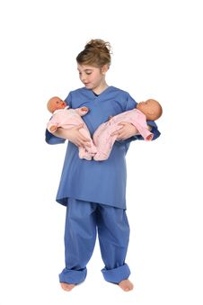 Free Doctor Little Girl Holding Two Dolls Royalty Free Stock Image - 10200646