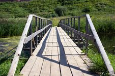 The Bridge Through The River On A Background Of A Stock Photo