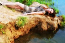 Free Woman Lays Near Water Stock Photography - 10205682