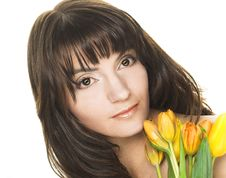 Free Woman With Yellow Tulips Stock Images - 10205804