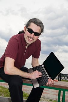 Free Guy With Laptop In The Park Royalty Free Stock Image - 10206516