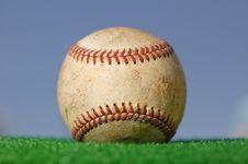 Baseball On Green Grass Stock Photo