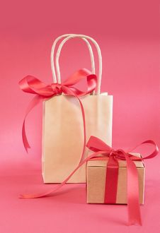 Bag And Present With Red Bow For Christmas Royalty Free Stock Photography