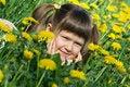 Free Little Cute Girl Is Lying On The Dandelion Meadow Royalty Free Stock Image - 10218746