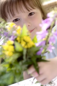 Little Girl With The Big Bouquet Stock Images