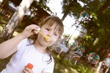Free Little Gir Concentrated On Blowing Soap Bubbles Royalty Free Stock Images - 10210699