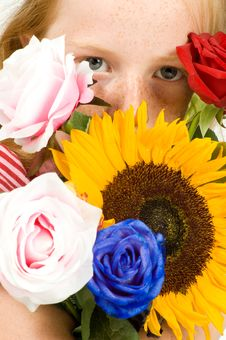 Free Girl Is Holding Lots Of Flowers Stock Photography - 10217792