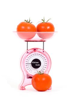 Kitchen Scales With Fresh Tomatoes Royalty Free Stock Photos