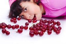 A Cute Girl Beside Many Pieces Of Cherry Stock Photos