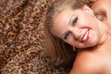 Free Beautiful Blonde Woman Poses On Leopard Blanket. Royalty Free Stock Photo - 10219755