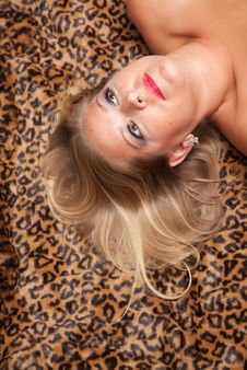 Free Beautiful Blonde Woman Poses On Leopard Blanket. Stock Images - 10219764