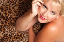 Free Beautiful Blonde Woman Poses On Leopard Blanket. Stock Image - 10219781
