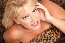 Free Beautiful Blonde Woman Poses On Leopard Blanket. Stock Images - 10219784