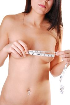 Woman Measuring Her Breasts. Royalty Free Stock Image