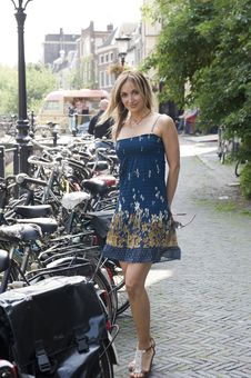 Free Woman Standing Next To Bicycle Royalty Free Stock Images - 10220949