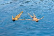 Free Young Couple Is Swimming In The Sea Royalty Free Stock Photos - 10225128