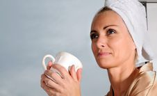 Coffee In Bathrobe Stock Image