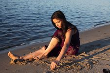 Free The Beautiful Girl On River Bank Stock Photos - 10227813