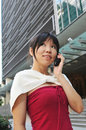 Free Asian Chinese Woman Answering Her Mobile Phone Royalty Free Stock Image - 10235266