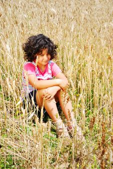 Free Little Pretty Girl Siting On Wheat Field Stock Photography - 10232212