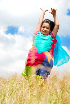 Free A Little Pretty Girl With Scarf Above Head On Medo Stock Photos - 10232893