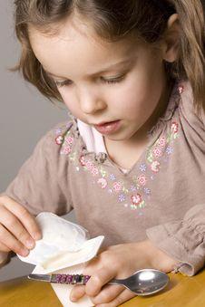 Free Girl Eating Yogurt Stock Photography - 10233892