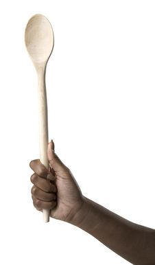 Free Hand Holding A Wooden Spoon Stock Photography - 10233982