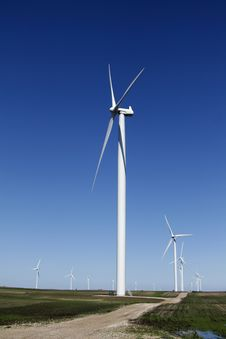 Free Wind Turbine On Dirt Road Stock Image - 10234081