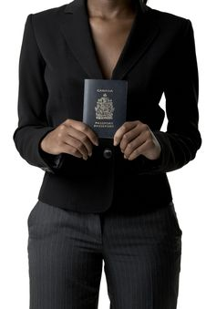 Free Woman Holding Canadian Passport Royalty Free Stock Photography - 10234107