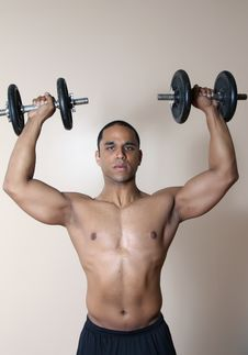 Free Muscular Male Body, Lifting Dumbbells Royalty Free Stock Photo - 10234915