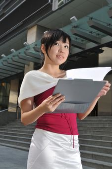 Free Asian Woman In The City Looking Through Her Files Stock Images - 10235314
