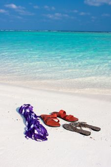 Free Tropical Beach With Slippers And Scarf Stock Photography - 10235522