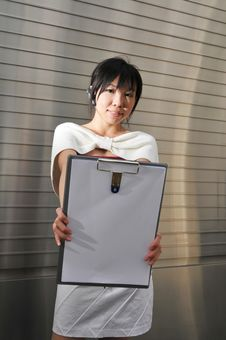 Free Asian Woman Holding A Clip Board Royalty Free Stock Photos - 10235698
