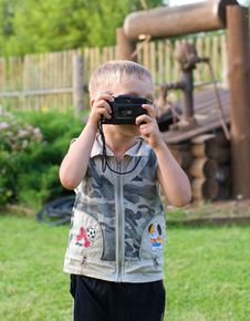 Free The Small Photographer. Royalty Free Stock Image - 10236646