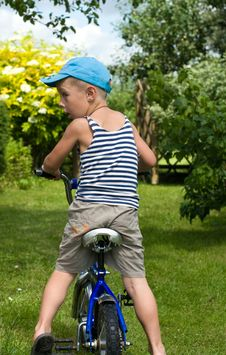 Free The Boy With A Bicycle Royalty Free Stock Image - 10236656