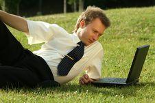 Man With Laptop Working Outdoor Stock Image