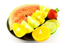 Watermelon With Citrus Wedges And Strawberry Stock Photography