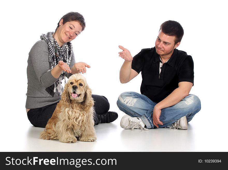 Girl, guy and american cocker spaniel