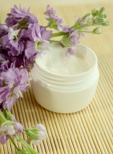 Free Spa Essentials. Cream And Flowers. Stock Images - 10244904