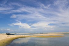 Blue Sky, White Clouds, Boat On A Sandbank, Sea Stock Image