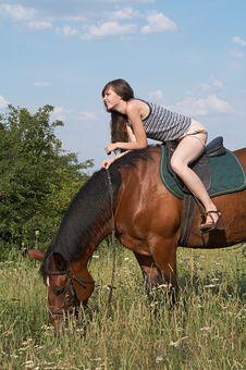 Free Girl Sits On Horseback Royalty Free Stock Photography - 10245977