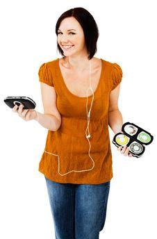 Caucasian Woman Listening Media Player Stock Photo