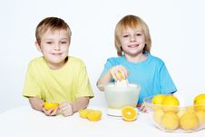 Children Squeeze Out Orange Juice Stock Photo