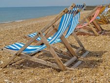 Free Deckchairs Lined Up On Beach. Stock Photography - 10249422