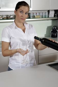 Free Young Attractive Woman Pouring Out Wine Royalty Free Stock Photos - 10250788