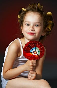 Curly Girl With Lollipop Stock Images