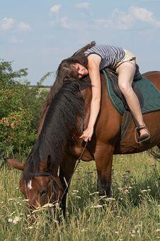 Free Girl Lies On Horseback Royalty Free Stock Photography - 10256037